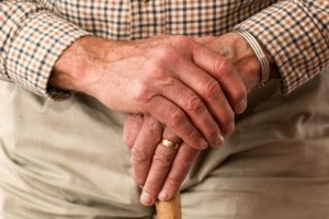 elderly hands clasped together